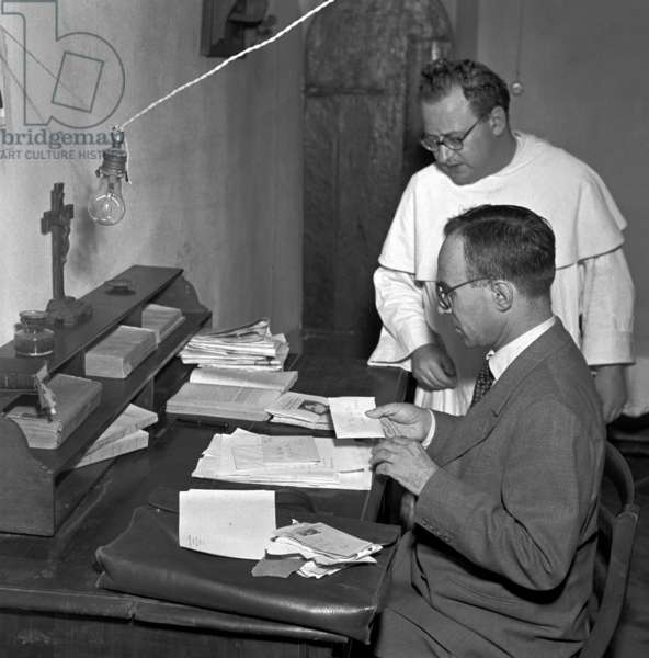 Florence, 1952. The former mayor of Florence Giorgio La Pira at his desk in the cell of the convent where he lived
