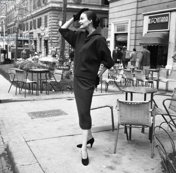 Fashion: Irene Galitzine Autumn Winter collection, worn by Joe Patterson, Rome, Italy, 1952 (b/w photo)