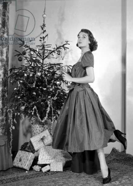 Fashion: Prada Winter collection with Christmas tree, Milan, Italy, 1954 (b/w photo)
