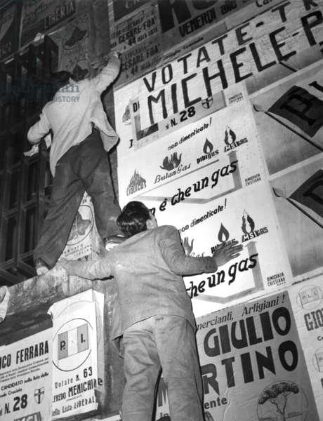 "Naples, 1953, Italian parliamentary elections of 1953, posters on the streets. ""The Battle of the Walls"" to the Conquest of Space"