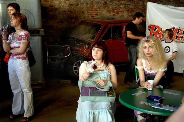 Young women has a rock concert in an old factory rehabilitated. Moscow Russia 07/2006