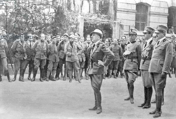 Gabriele D'Annunzio holding a speech in front of the legionnaires during the celebration of St Gabriel, March 18, 1920, Rijeka, Croatia, from L'Illustrazione Italiana, Year XVLII, No 12-13, March 21-28, 1920.