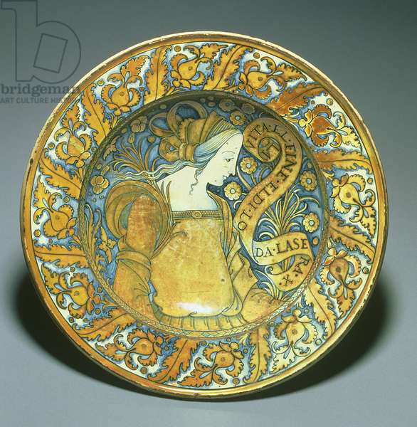 Dish depicting a young woman in profile with the inscription, 'Life by its end, day by evening is praised', from Deruta, Piatto da Pompa dish, c.1500-30 (ceramic lustreware)