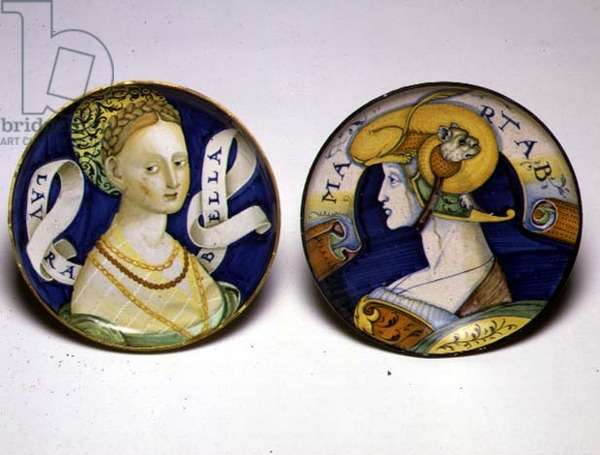 (L) MAR.C.65-1912 & (R) C.63-1927 Two dishes decorated with figures (L):  Bust of a young woman, (R): Bust of a female warrior wearing a parade helmet, c.1520-35, Castel Durante or Urbino (tin-glazed earthenware)