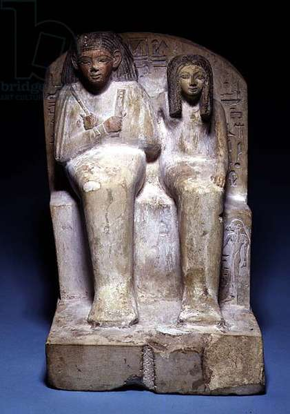 Pair statue of Kerem, scribe and door keeper of the chapel of the goddess Hathor, and his wife Abykhy, from Thebes, New Kingdom (painted limestone)