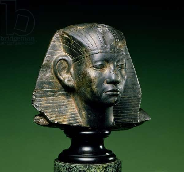 Head of King Amenemhat III, from Aswan, Middle Kingdom, 1842-1797 BC (dark fossiliferous limestone)