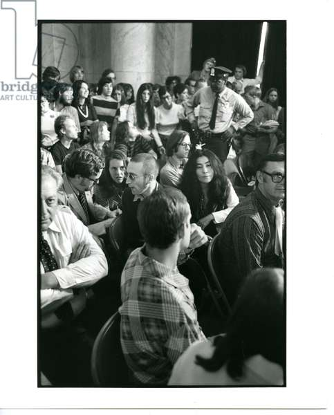 Spectators during the Watergate hearings, including John Lennon and Yoko Ono, June 26, 1973 (b/w photo)