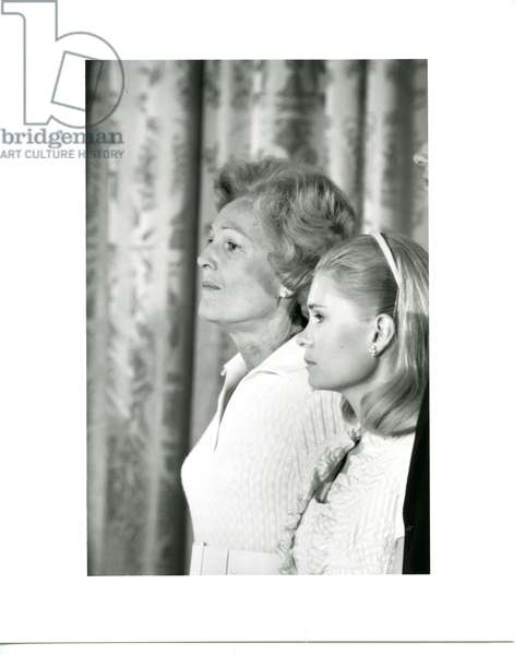 Mrs. Nixon and her daughter, Tricia, during President Nixon's farewell speech in the East Room of the White House, August 9, 1974 (b/w photo)