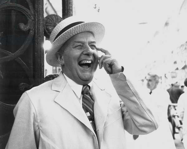 John Betjeman laughing wearing hat
