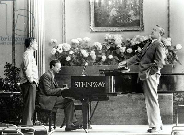 Benjamin Britten playing the piano accompanying Peter Pears singing