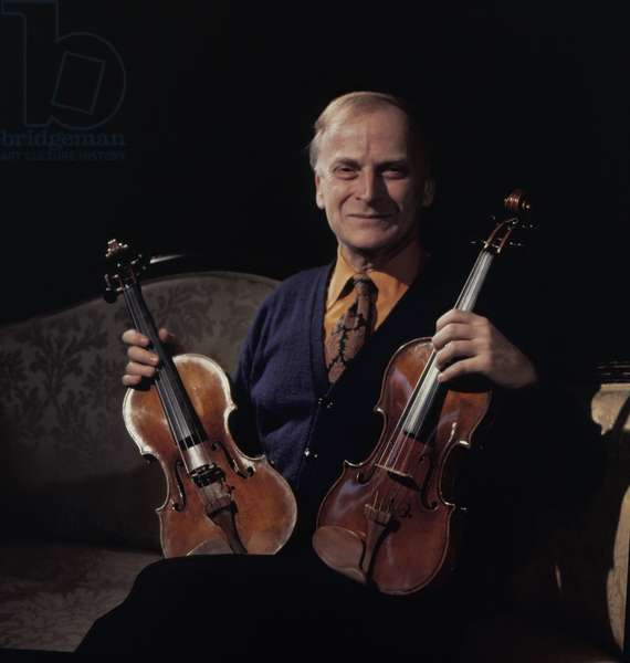 MENUHIN, Yehudi - holding two of his STRADIVARIUS violins, 1970