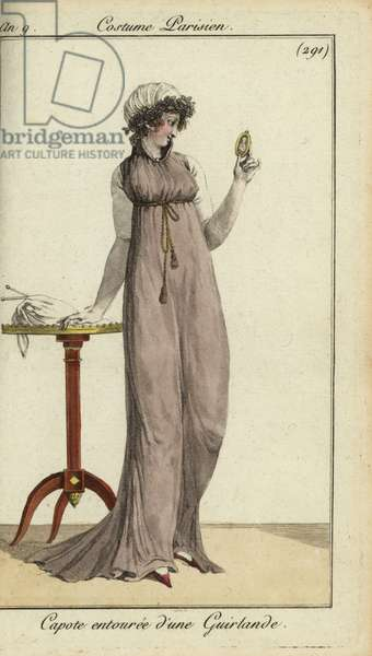Fashionable woman looking at a locket, 1801 (handcoloured copperplate engraving)