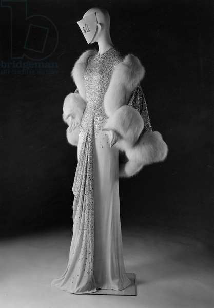 Embroidered evening dress and matching stole by Norman Hartnell, 1960 (silk jersey, sequins & white fox fur)
