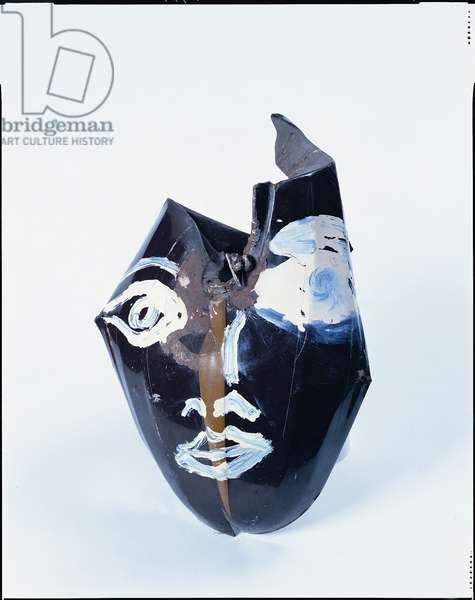 Head (oil paint on motor bicycle tank)