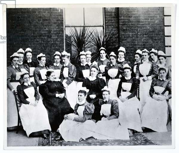 Miss Gordon, Miss Crossland and twenty nurses and sisters (b/w photo)