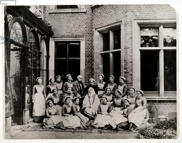 Florence Nightingale with Sir Harry Verney and Miss Crossland, in the centre of a group of nurses at Claydon House, 1886 (b/w photo)