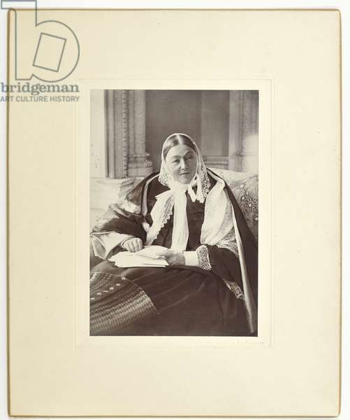 Florence Nightingale, seated on a couch in the Blue Room at Claydon House, 1891 (b/w photo)