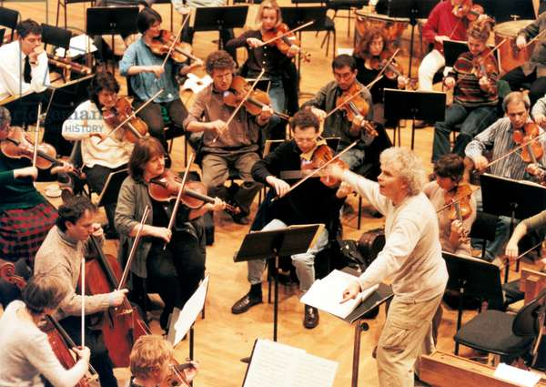Simon Rattle conducting the