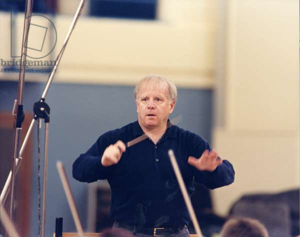 Leonard Slatkin conducting with
