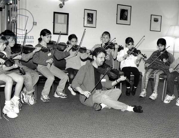 Children playing violin at