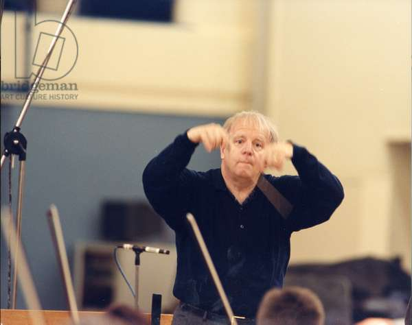 Leonard Slatkin conducting with