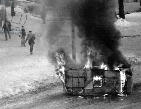 Gdansk December 1981. Martial Law in Poland. A ZOMO vehicle burns on Hucisko roundabout in Gdansk after riots.