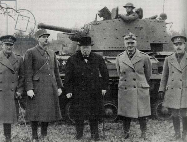 1941. General De Gaulle, Prime Minister Winson Churchill nd General Wladysalw Sikorski visiting the 10th Calvary Brigade. Armored tank and soldier in background.