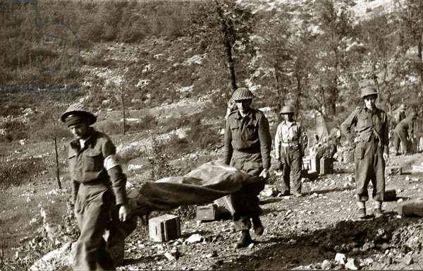 Monte Cassino, Italy, 05.1955. Polish soldiers of the II Polish Corps carrying the dead bodies of Polish soldiers who fell during the battle for Monte Cassino.