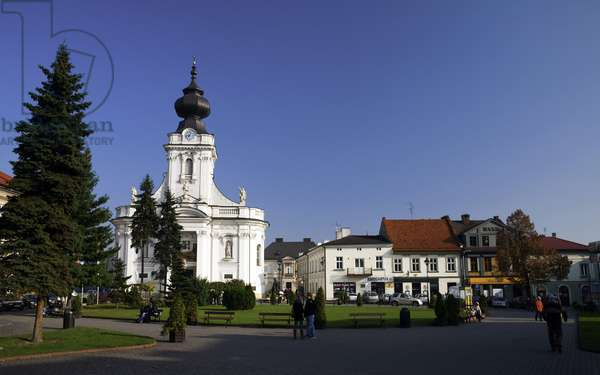 Wadowice, town in Souther Poland, 50km from Cracow, the birthplace of pope John Paul II. Virgin Mary's Offertory minor basilica at the market square. at right: faimly house of the pope Lesser Poland Province, 2009