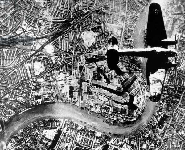 A German Heinkel He 111 bomber flying over London, England, September 1940 (b/w photo)