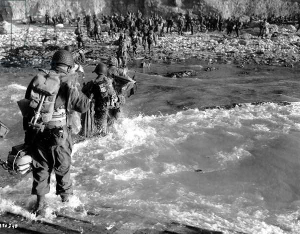 Troops of the 5th Engineer Special Brigade wade through the surf at atFoxGreen, Omaha Beach, Normandy, France, 8th June 1944 (b/w photo)