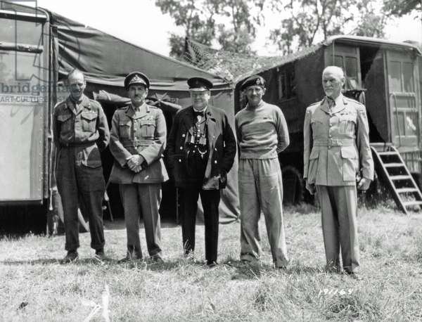 Lieutenant General Miles Dempsey, Field Marshall Lord Alanbrooke, Winston Churchill, Prime Minister of United Kingdom, Field Marshal Bernard Montgomery, and Prime Minister Jan Christiaan Smuts of the Union of South Africa at Château de Creully, Normandy, France, 12th June 1944 (b/w photo)