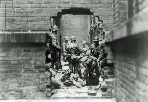 Japanese soldiers are involved in street fighting in Shanghai, China, 1937 (b/w photo)