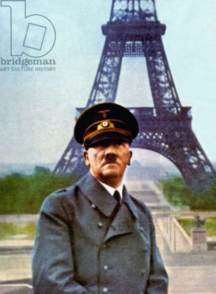 Adolf Hitler posing in front of the Eiffel Tower after the surrender agreement has been signed in Compiègne, Paris, France, 23rd June 1940 (photo)