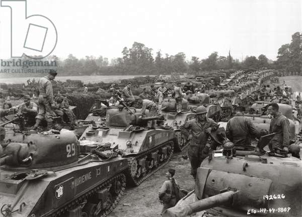A large group of Sherman tanks of the 2nd French Armored Division which had landed at Saint Martin de Varreville, Normandy, France, August 1944 (b/w photo)