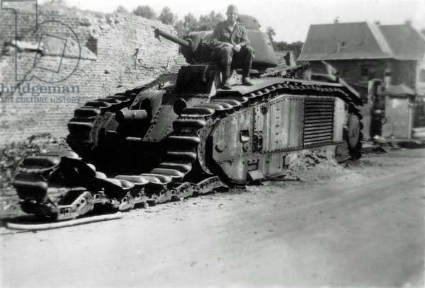 A German soldier poses on a French Char Renault B1 SENEGAL No. 209, France, 1940 (b/w photo)