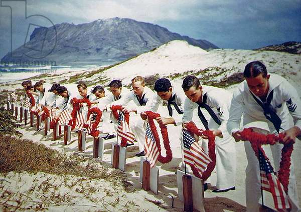 Enlisted men of the Naval Air Station at Kaneohe, Hawaii, place leis on the graves of their comrades killed in the Japanese attack on Pearl Harbor last December 7, 27th May 1942 (photo)