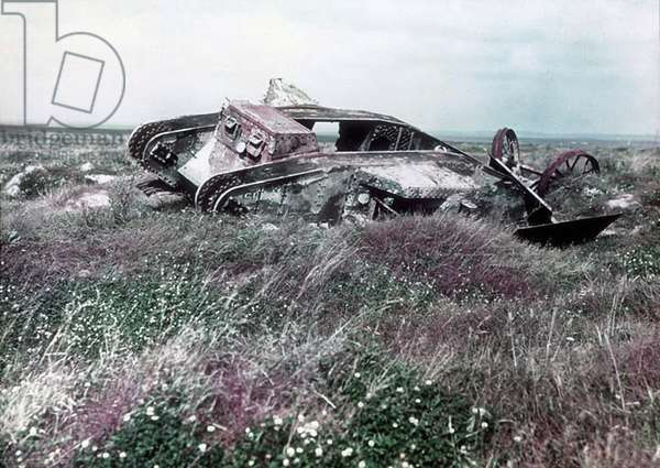 The remains of a British Mark I Male tank, C1 tank on the Pozières battlefield previously used by a Canadian Division for their attack on German positions near Courcelette, France, September 15, 1916 (colour Paget plate)