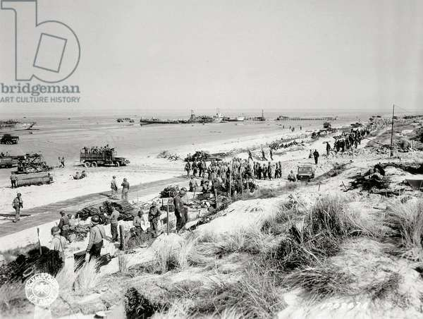 Equipment and vehicles are unloaded on the beaches, Utah Beach, Normandy, France, 8th June 1944 (b/w photo)