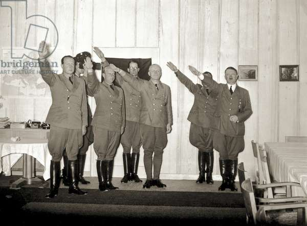 Adolf Hitler and visitors of the Berghof presenting the Nazi or Hitler salute, which was adopted by the Nazis in the 1930s, 1942 (b/w photo)