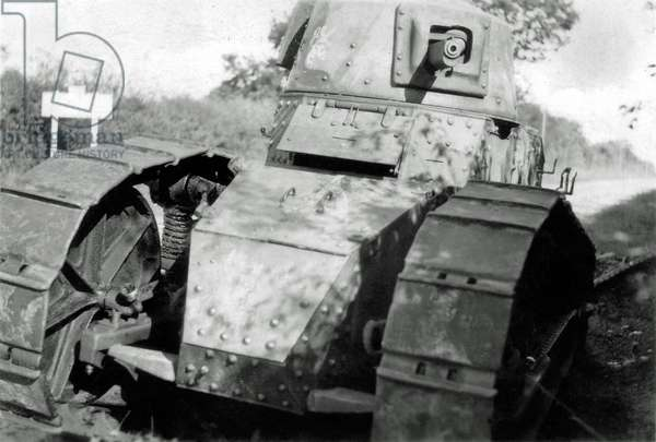 An abandoned French tank FT-31 on the edge of a road, France, 1940 (b/w photo)