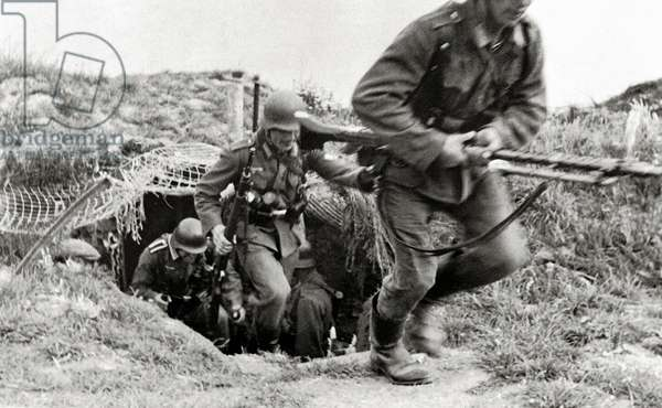 German troops leaving their bunker with weapons, Normandy, France, June 1944 (b/w photo)
