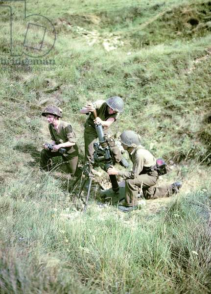 Soldiers of the 3rd Canadian Infantry Division with a mortar near Juno Beach where they landed on D-Day, 6th June 1944 (photo)
