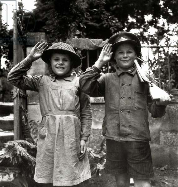 Two children, 10 and 13 years old, posing with Canadian helmet and hat, north of Caen, Normandy, France, 28th June 1944 (b/w photo)