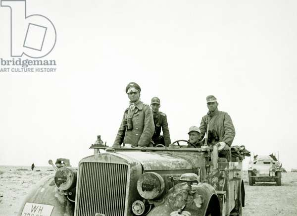 Field Marshal Erwin Rommel (Desert Fox) with the 15th Panzer Division between Tobruk and Sidi Omar during the siege, Libya, April 1941 (b/w photo)