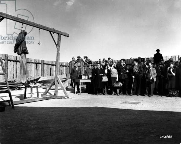 Civilians from nearby Weimar are brought into Buchenwald concentration camp to see the evidence of the atrocities commited, 16th April 1945 (b/w photo)