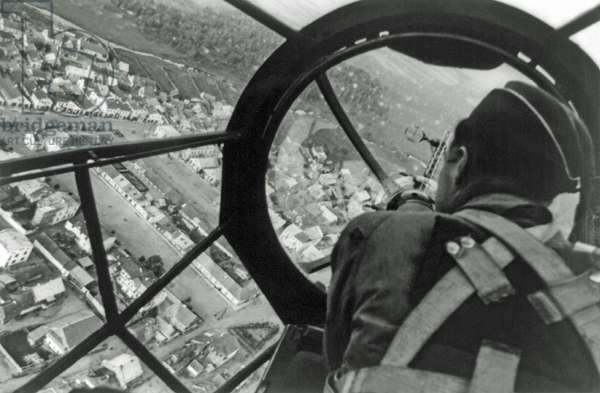 View of an undamaged Polish city from the cockpit of a German medium bomber aircraft, likely a Heinkel He 111 P, Poland, October 1939 (b/w photo)