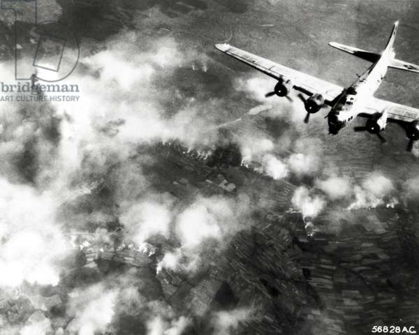 A B-17 Flying Fortress of the 15th US Army Air Force attacking the factories at Monowitz, 20th August 1944 (b/w photo)