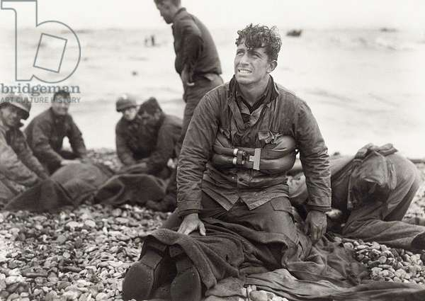 These U.S. soldiers reached Omaha Beach by using a life raft, Normandy, France, 6th June 1944 (b/w photo)