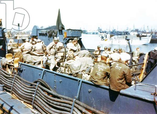 Soldiers of the 1st Infantry Division of the United States Army board the Landing Craft Transport 'Channel Fever' in Southern England, June 1944 (photo)